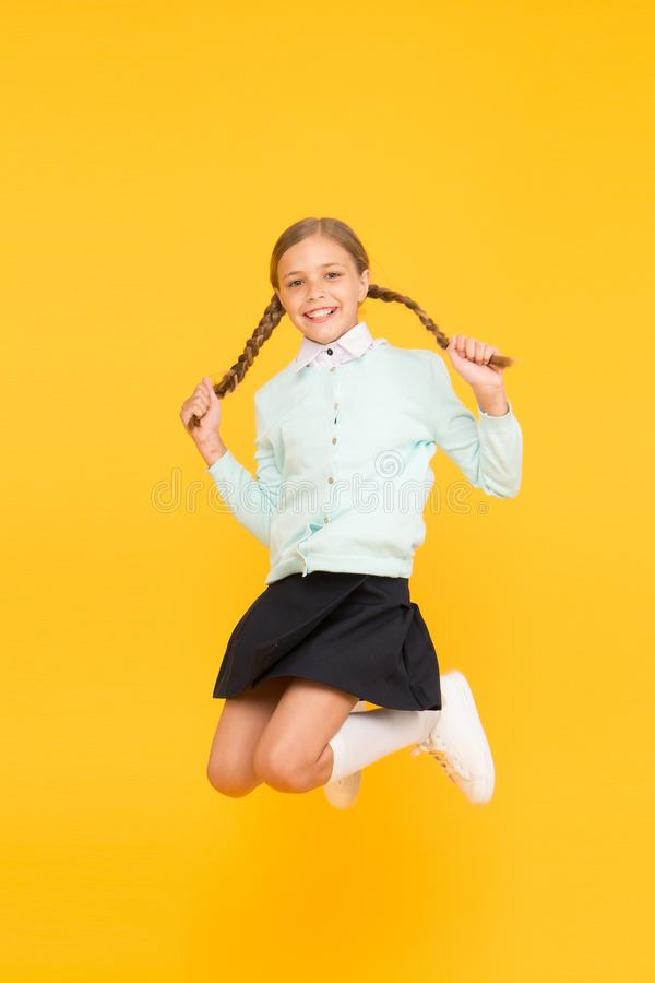 Childhood happiness. Kid cute student. Schoolgirl excellent pupil jump mid air. Schoolgirl tidy appearance school. Uniform. September again. School day fun stock image