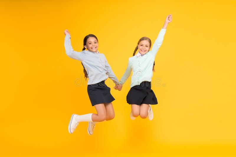 Childhood happiness. School day fun cheerful moments. Kids cute students. Schoolgirls best friends excellent pupils stock photo