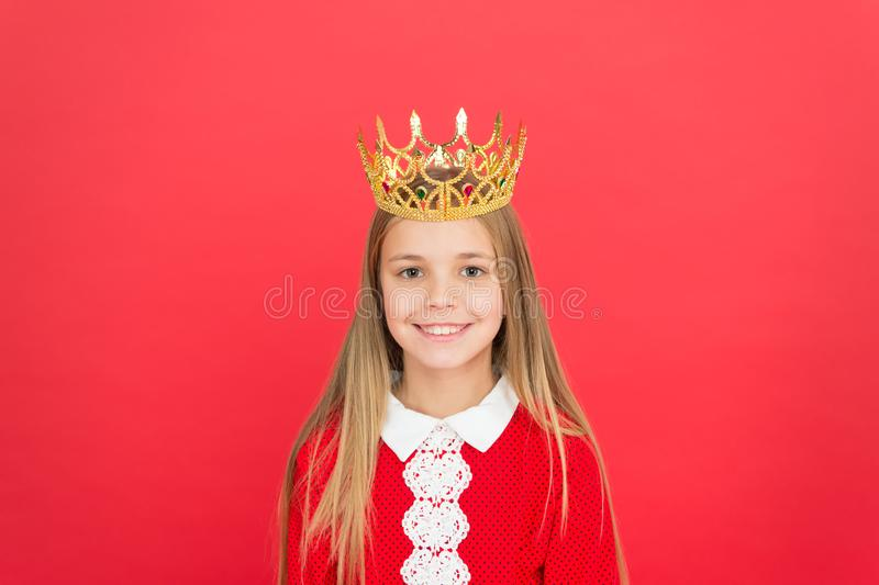 Childhood happiness. small girl child. School education. family love. childrens day. Good parenting. Child care. happy. Little girl on red background. littlle royalty free stock image