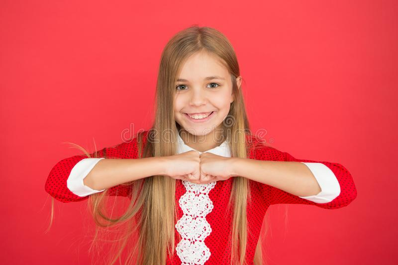 Childhood happiness. small girl child. School education. family and love. childrens day. Good parenting. Child care. Happy little girl on red background stock image