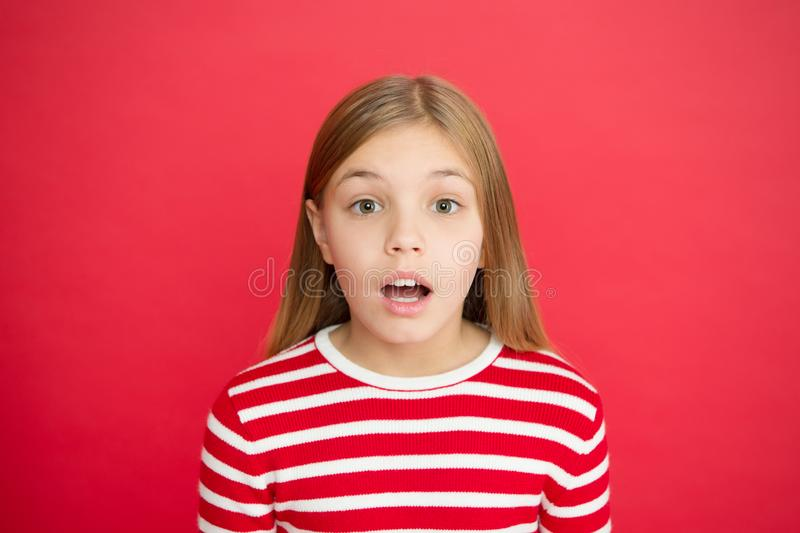 Childhood happiness. small girl child. School education. family and love. childrens day. Good parenting. Child care. Surprised little girl on red background stock image