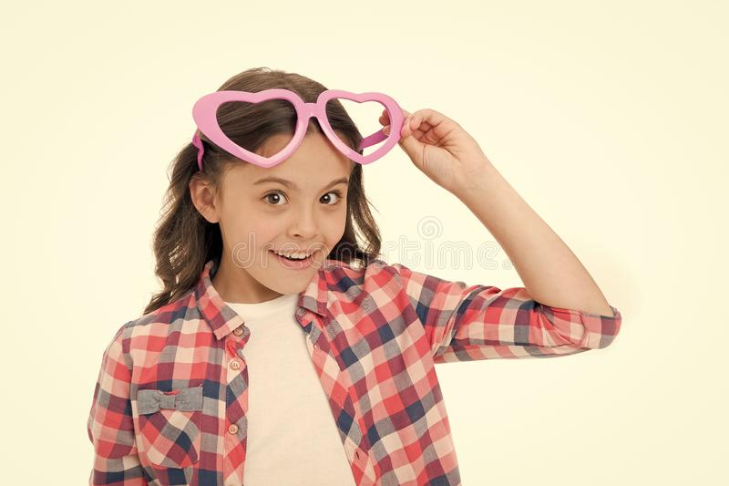 Childhood love. Kid happy lovely feels sympathy. Child charming smile fall in love. Girl heart shaped eyeglasses. Celebrates valentines day. Girl cute smiling royalty free stock photo