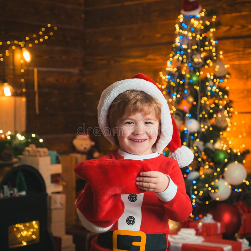 Childhood moments. Child cheerful face got gift in christmas sock. Check contents of christmas stocking. Joy and. Happiness. Christmas stocking concept. Kid boy stock images