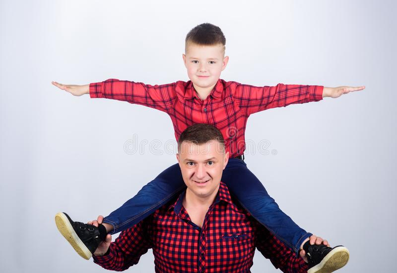Childhood. parenting. fathers day. Enjoying time together. father and son in red checkered shirt. small boy with dad man. Happy family together. feel freedom stock image