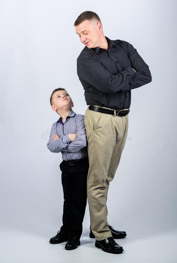 Childhood. parenting. fathers day. father and son in business suit. happy child with father. business partner. little. Boy with dad businessman. family day royalty free stock photo