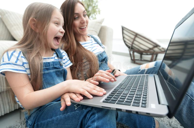 Happy mother with adorable little girl with laptop stock photos