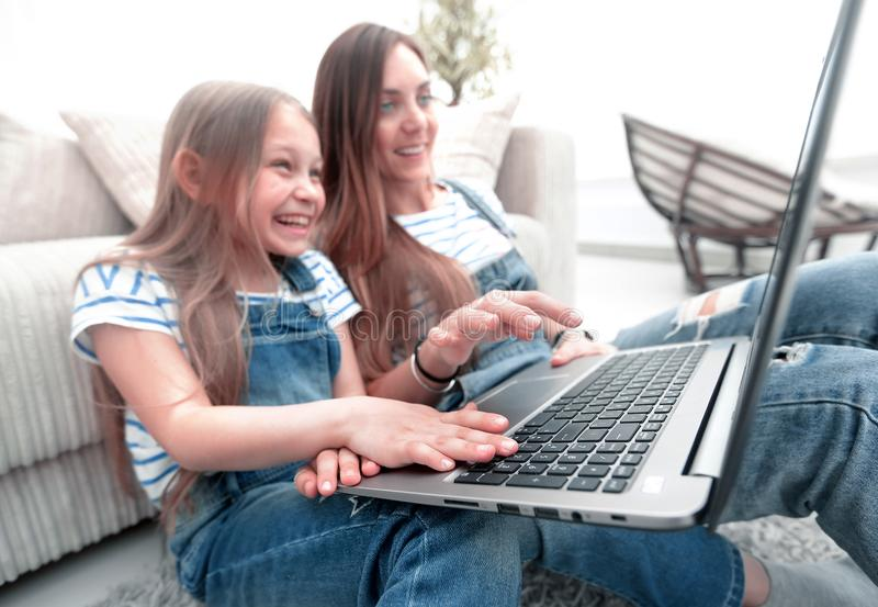 Happy mother with adorable little girl with laptop royalty free stock images