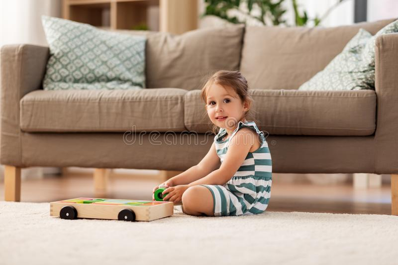 Happy baby girl playing with toy blocks at home royalty free stock images