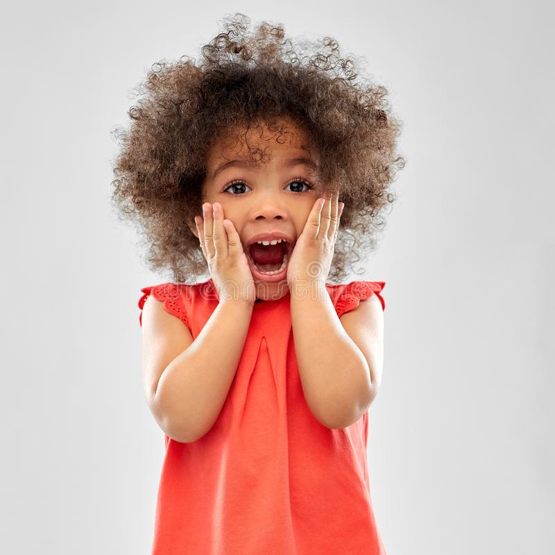 Surprised or scared little african american girl royalty free stock photo