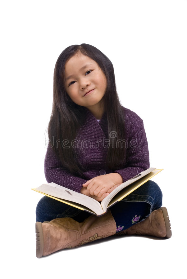 Childhood Series 8 (Reading a book) stock photo