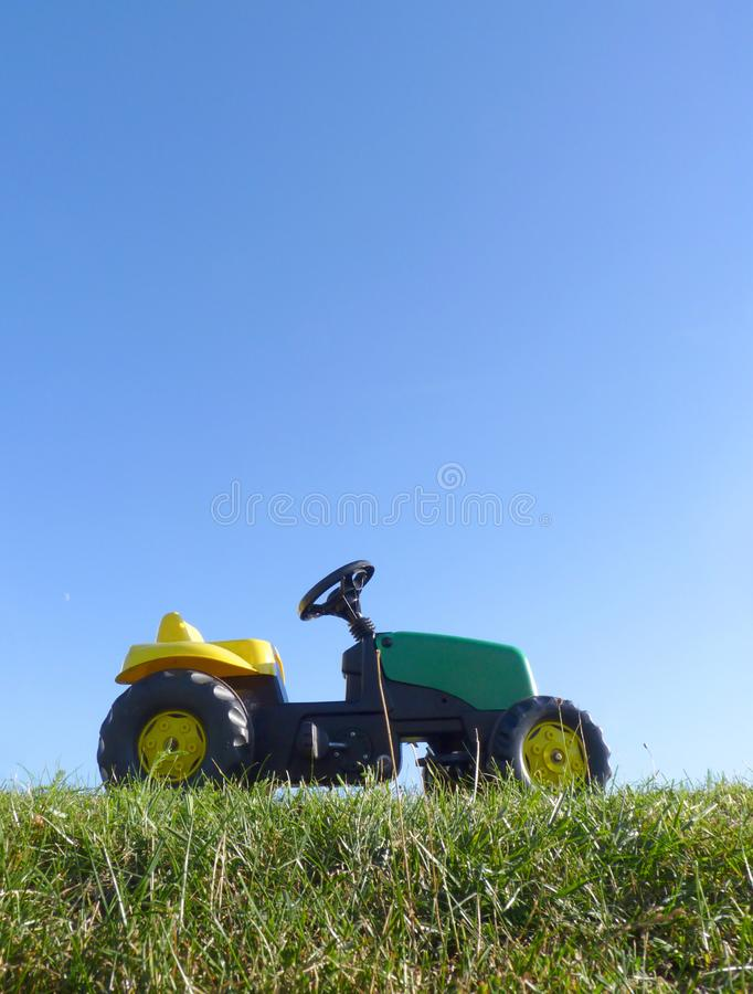 Childhood Toy Pedal Tractor Car stock photo