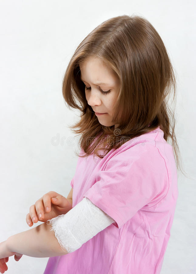 Childhood trauma. A child with a bandage tied hand royalty free stock photos