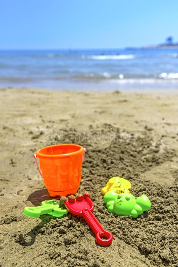 Childhren`s bucket and other sand molding toys on the beach, outdoors royalty free stock photography