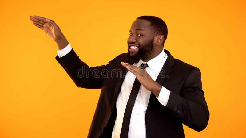 Childish joyful african-american businessman making dancing movements, success. Stock photo royalty free stock photos
