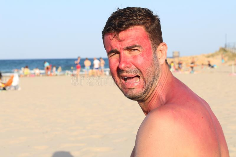 Childish looking adult crying at the beach stock photography