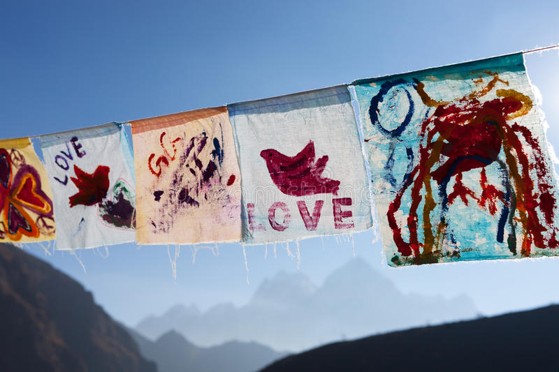 Childish painting of red pigeon hand drawn on. Childish painting of red pigeon hand drawn on white cloth. Hand painted flags waving on a bright sunny day. Love stock photos