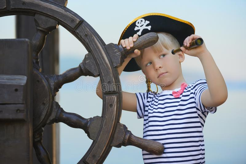 Childish reality unseen to adults. Little girl playing pirates royalty free stock photo