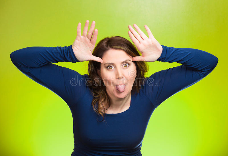 Childish rude bully woman sticking tongue out stock photo