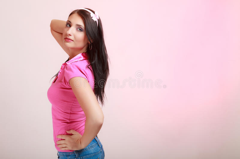 Childish young woman infantile girl in pink. Longing for childhood. Portrait of childish young woman with headband on her hair. Infantile girl on pink. Longing royalty free stock image