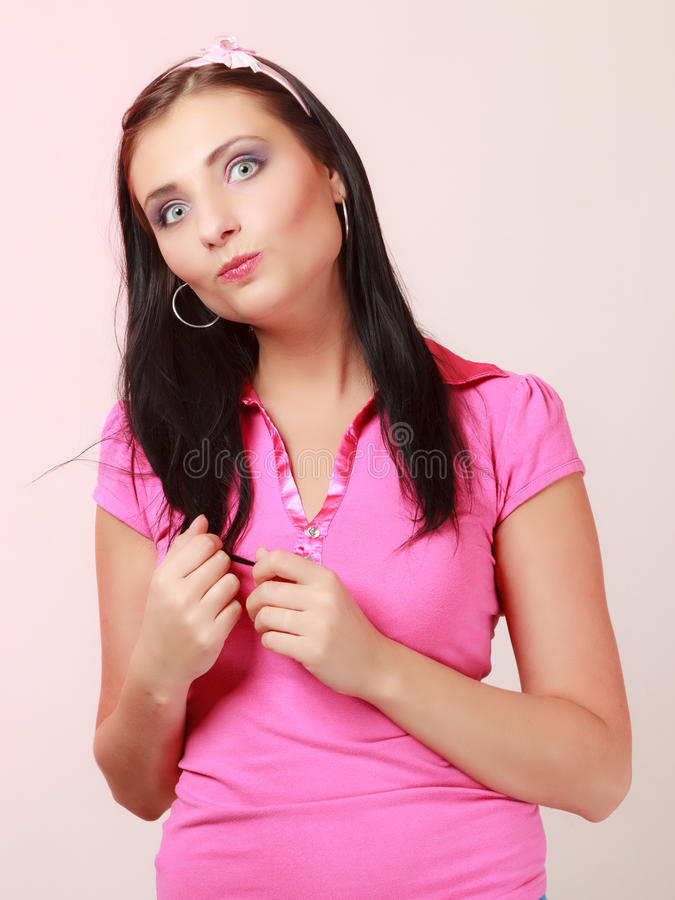 Childish young woman infantile girl in pink. Longing for childhood. Portrait of childish young woman with headband on her hair. Infantile girl making funny stock photos