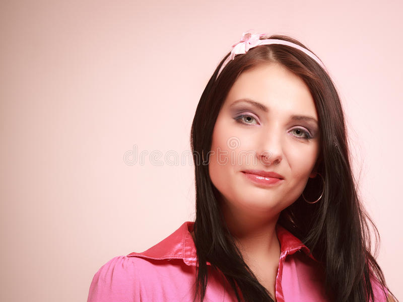 Childish young woman infantile girl in pink. Longing for childhood. Portrait of childish young woman with headband on her hair. Infantile girl on pink. Longing royalty free stock photo