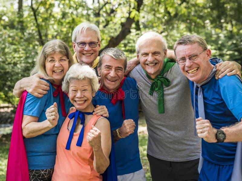 Childlike seniors wearing superhero costumes royalty free stock photos