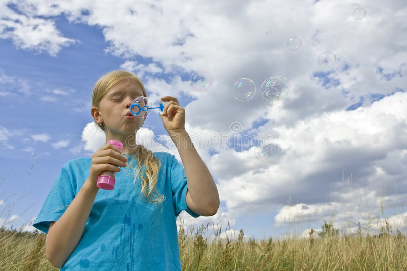 Download Childrem blowing bubbles stock image. Image of meadow - 7161455
