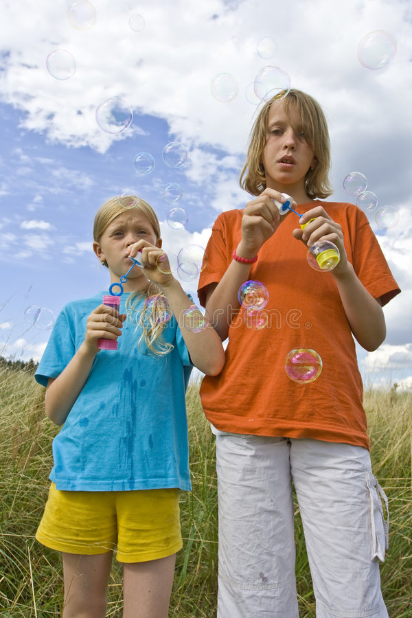 Download Childrem blowing bubbles stock photo. Image of play, together - 7161536