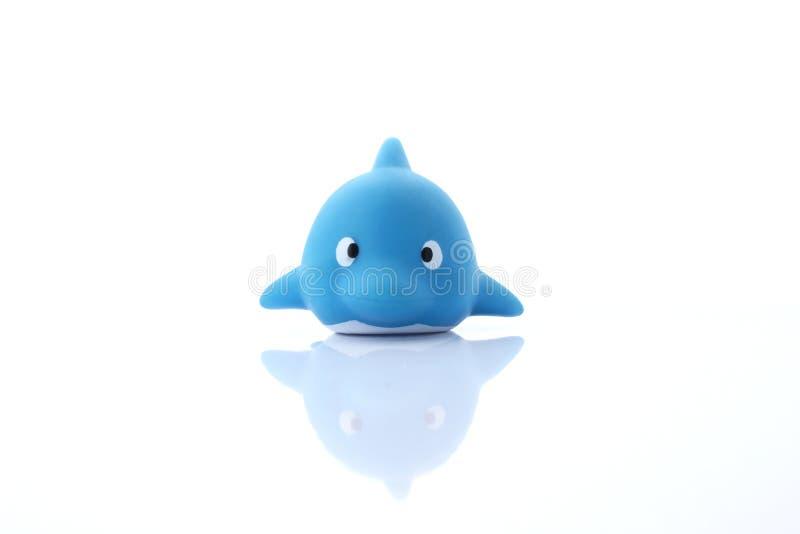 Children& x27; дельфин игрушки s резиновый стоковые изображения