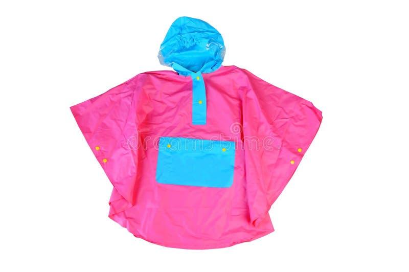Children& x27; 小女孩的s明亮的时兴的桃红色夹克,有敞篷的防风上衣,按了有口袋的雨衣被隔绝 免版税库存照片