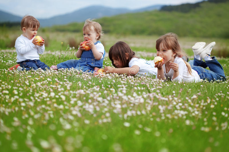 Children. Cute happy children playing in spring filed