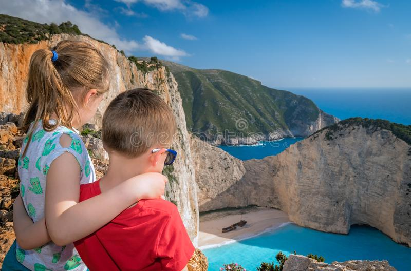 Children admiring stunning Shipwreck Cove. Brother and sister standing together on the viewpoint and admiring stunning view of the cliffs in Shipwreck Cove stock photography