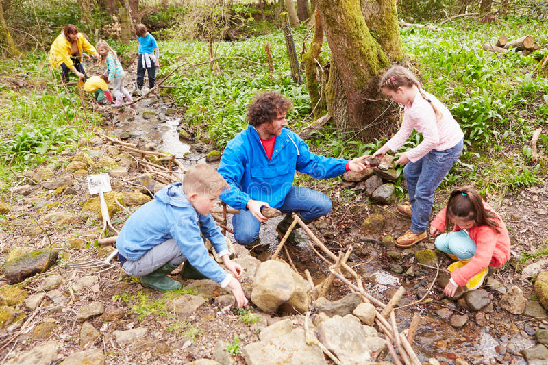 Download Children And Adults Carrying Out Conservation Work On Stream Stock Image - Image of mending, clearing: 59780507