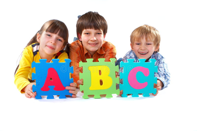Children with Alphabet Puzzle royalty free stock image