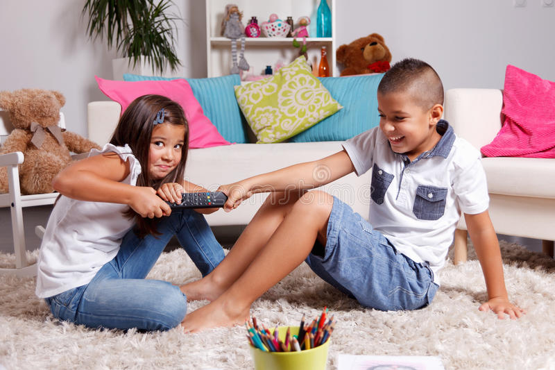 Children arguing about watching TV royalty free stock photography