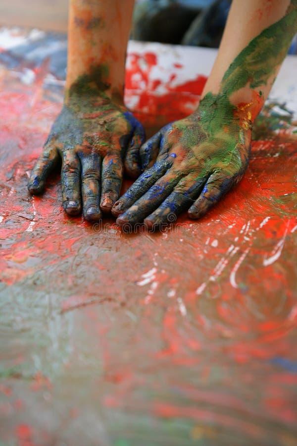 Children artist hands painting multi colors stock image