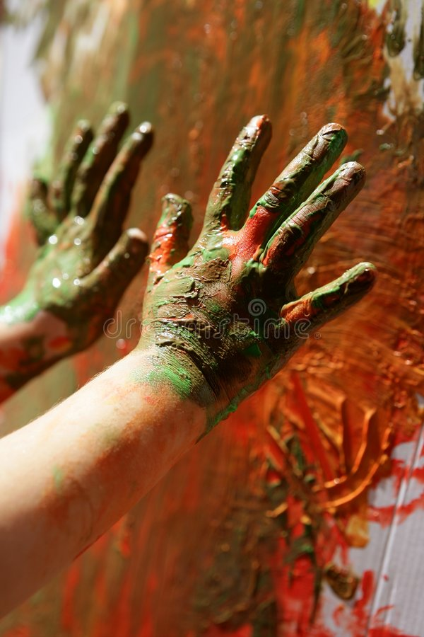 Children artist hands painting multi colors stock images