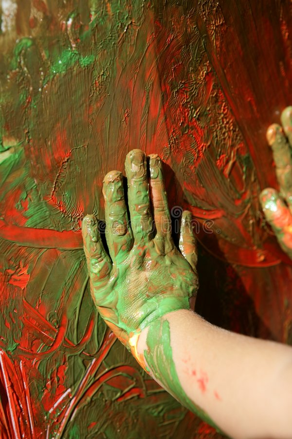 Children artist hands painting multi colors stock photo