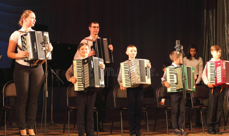 Children artists. Children's musical ensemble of accordionists on the stage of the Kyiv Palace of children and youth. the city of Kiev. festival Steps talents stock image