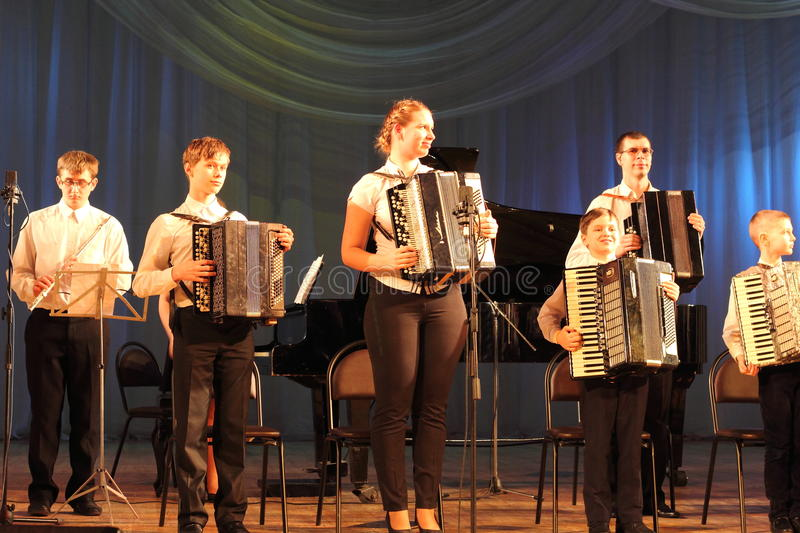 Children artists. Children's musical ensemble of accordionists on the stage of the Kyiv Palace of children and youth. the city of Kiev. festival Steps talents stock photo