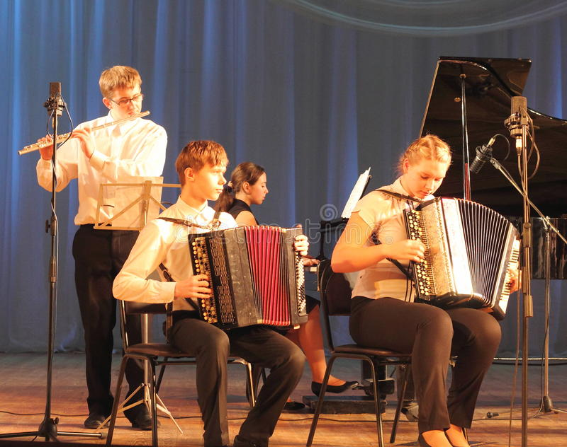 Children artists. Children's musical ensemble of accordionists on the stage of the Kyiv Palace of children and youth. the city of Kiev. festival Steps talents stock photography
