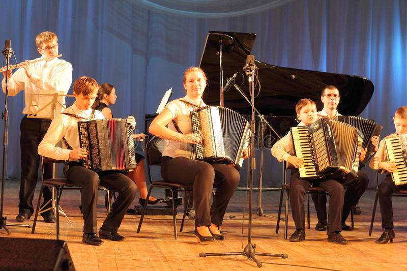 Children artists. Children's musical ensemble of accordionists on the stage of the Kyiv Palace of children and youth. the city of Kiev. festival Steps talents royalty free stock images