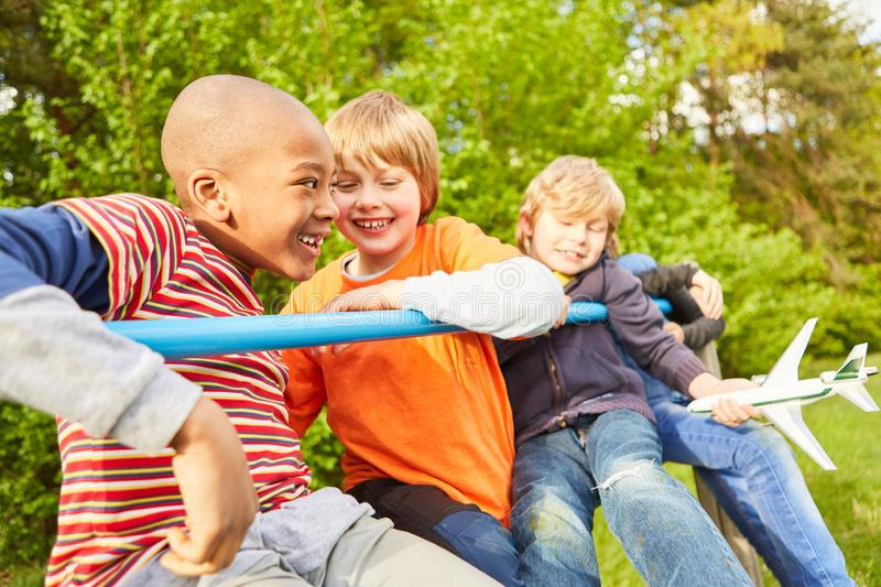 Children as friends play on a jungle gym royalty free stock photography