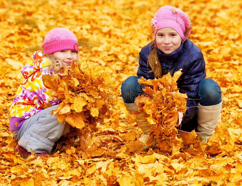 Children at autumn park stock photography