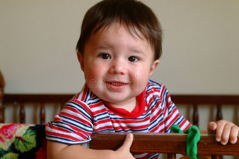 Children- Baby in Crib royalty free stock photos