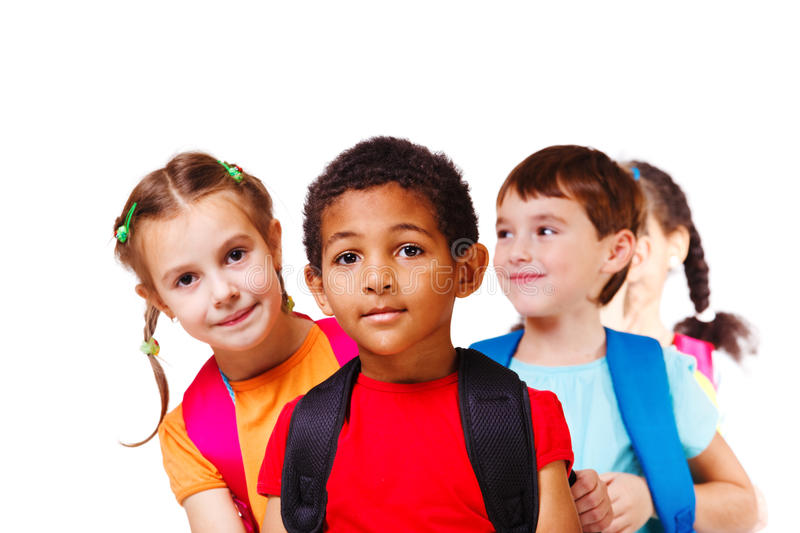 Children with backpacks royalty free stock images