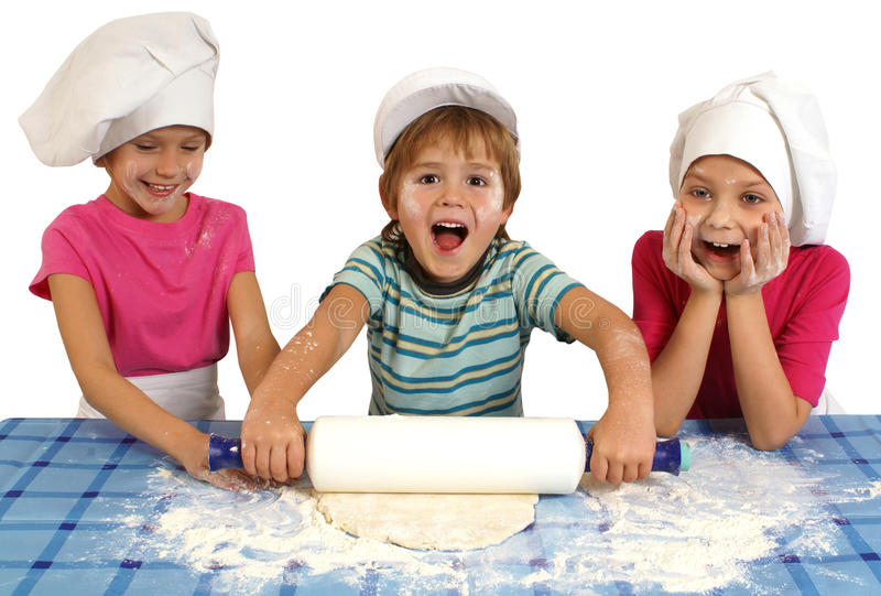 Children baking. Messy children preparing dough. Isolated on white royalty free stock photos