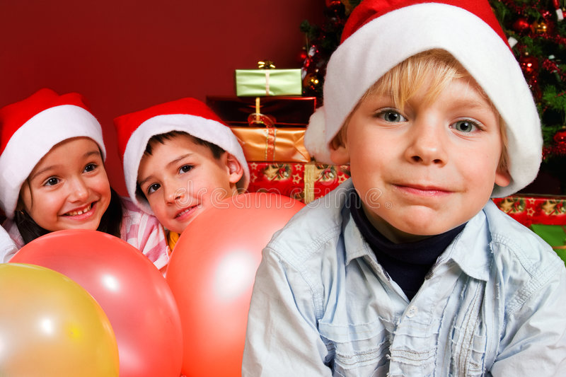 Download Children With Ballons By Christmas Tree Stock Photo - Image: 7150934