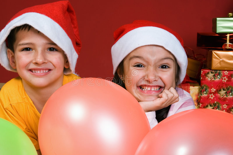 Children With Ballons By Christmas Tree Royalty Free Stock Images