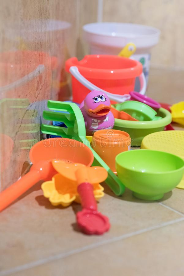 Children bath plastic toys put in the bathroom which have a pink small duck in the middle. stock photo